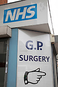 Sign for the NHS National Health Service outside a GP doctors clinic in London, UK.