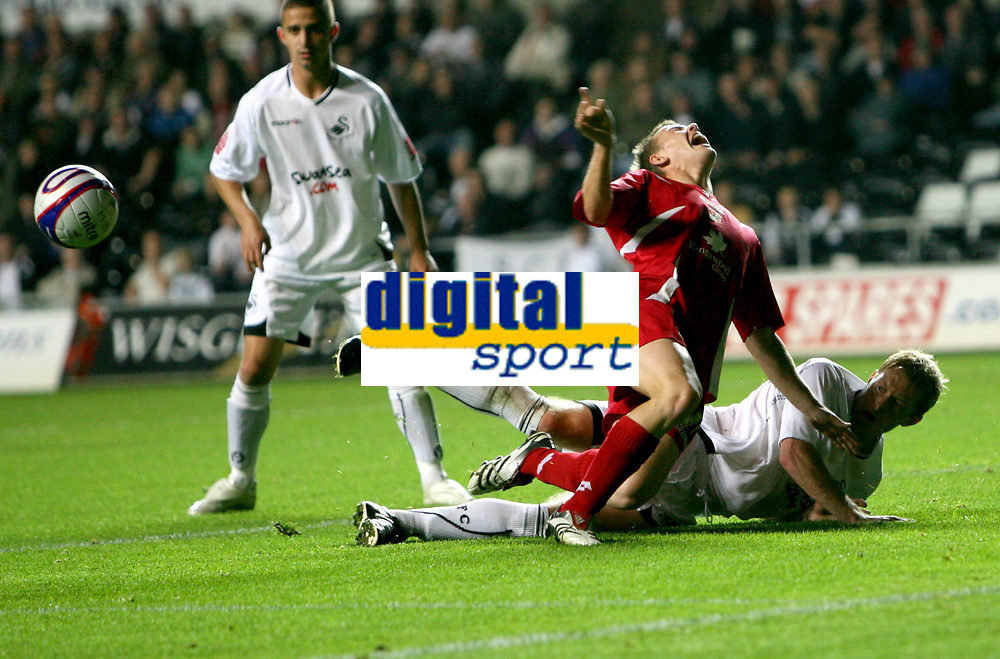 Photo: James Davies.<br />Swansea City v Swindon Town. Coca Cola League 1. 02/10/2007. <br />Swindon`s Simon Cox is brought down by Garry Monk.