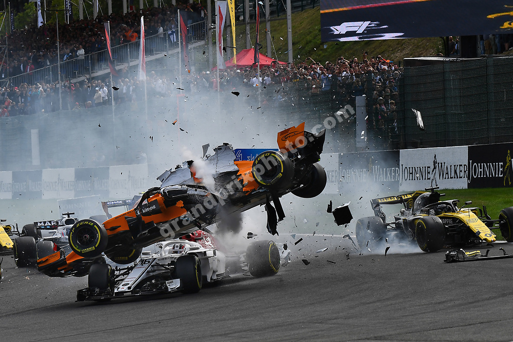 Charles Leclerc (Sauber-Ferrari), Fernando Alonso (McLaren-Renault) and Nico Hülkenberg (Renault) crash in the first corner after the start of the 2018 Belgian Grand Prix at Spa-Francorchamps. Photo: Grand Prix Photo