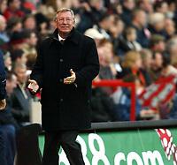Photo: Chris Ratcliffe.<br />Charlton Athletic v Manchester United. The Barclays Premiership. 19/11/2005.<br />Alex Ferguson celebrates as Alan Smith scores the opener