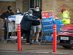 © Licensed to London News Pictures. 03/11/2020. Watford, UK. Shopper push a trollies fully of supplies from COSTCO in Watford, Hertfordshire ahead of a second national lockdown later this week. Strict measures are due to be re-introduced in an attempt to fight a second wave of the COVID-19 strain of Coronavirus. Photo credit: Ben Cawthra/LNP