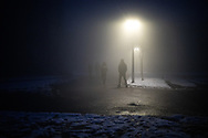 Migrants walking in the foggy streets of Bihac close to the Dom Penzionera. A group of more than 100 migrants are squatting an abandoned building  in the town of Bihac, Bosnia Herzegovina not far from the Croatian border, living without running water electricity and warming themself close to smokey bonfires. January 26, 2021. Federico Scoppa
