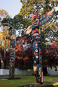 Totem poles in Thunderbird Park, downtown Victoria, Vancouver Island, British Columbia, Canada.