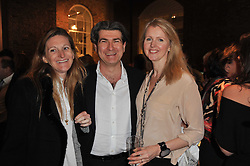 Left to right, RACHEL WHETSTONE and OCTAVIUS & JOANNA BLACK at a party to celebrate the launch of Simon Sebag-Montefiore's new book - 'Jerusalem: The Biography' held at Asprey, 167 New Bond Street, London on 26th January 2011.