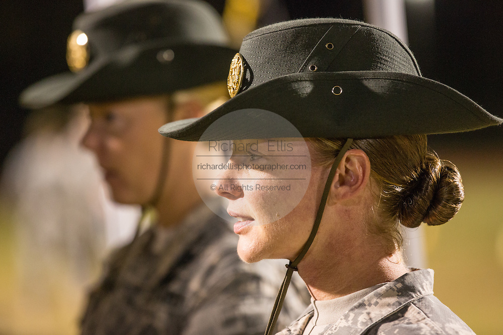 A woman Drill Sergeant instructor observes candidates at the US Army Drill Instructors School Fort Jackson September 27, 2013 in Columbia, SC. While 14 percent of the Army is women soldiers there is a shortage of female Drill Sergeants.