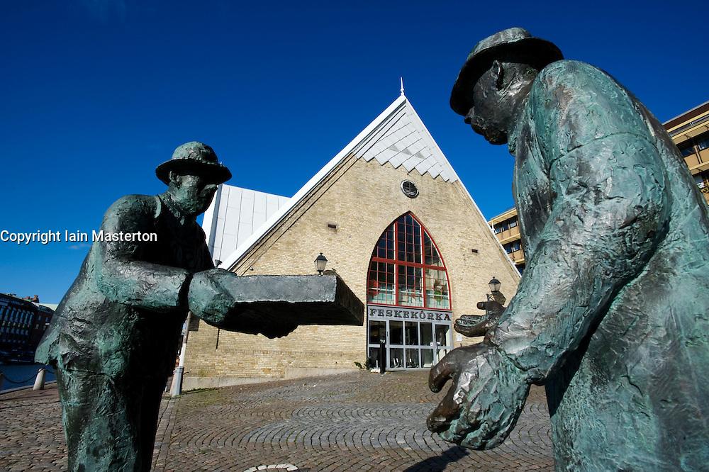 Sculpture of fishmarket workers outside famous historic Feskekorka Fish Market in Gothenburg Sweden
