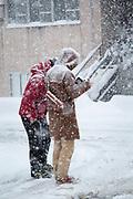 Two tourist walking in snow, Nozawaonsen, Japan
