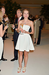 CHARLES & AGNIESZKA BUTTER at a dinner hosted by Cartier in celebration of The Chelsea Flower Show held at The Hurligham Club, London on 19th May 2014.