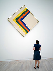 Woman looking at painting Swing by Kenneth Noland  at K20  art museum or Kunstsammlung at Grabbeplatz Dusseldorf Germany