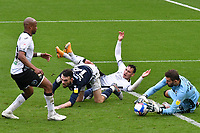 Football - 2020 / 2021 Sky Bet Championship - Swansea City vs Birmingham City - Liberty Stadium<br /> <br /> André Ayew of Swansea City leads a foal mouth scramble
