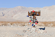 Teakettles adorn the sign at Teakettle Junction in Death Valley National Park along this very remote dirt road in the middle of nowhere.