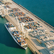 An aerial view of containers and a large container ship at the docks in Cape Town, South Africa