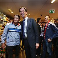 Nederland, Amsterdam , 30-10-2014.<br /> Bedrijfsbezoek van minister-president Mark Rutte op uitnodiging van Ahold/Albert Heijn aan Albert Heijn filiaal in de Molukkenstraat in Amsterdam Oost.<br /> <br /> <br /> Foto:Jean-Pierre Jans/ANPinOpdracht