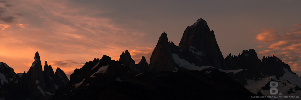 A four image high resolution panoramic of the skyline above El Chalten, Argentina featuring the prominent peaks of Montt Fitz Roy and Cerro Torre in Patagonia, Argentina at Sunset.