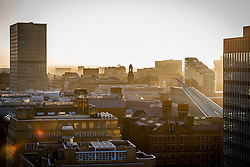 © Licensed to London News Pictures . 14/11/2013 . A boiling orange winter sunset above Manchester City Centre this evening (14th November 2013) . Photo credit : Joel Goodman/LNP