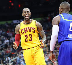 March 3, 2017 - Atlanta, GA, USA - Cavaliers forward LeBron James reacts after scoring against the Hawks Paul Millsap looking for a foul on the play during the first half in a NBA basketball game at Philips Arena on Friday, March 3, 2017, in Atlanta, GA. (Credit Image: © Curtis Compton/TNS via ZUMA Wire)