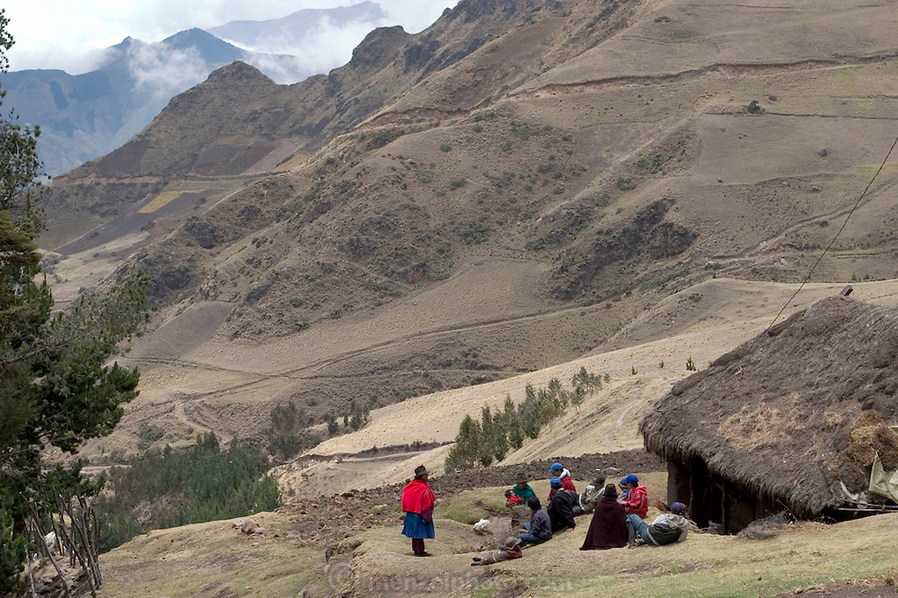 The Ayme family outside their thatch-roofed adobe-brick-walled cooking hut. The Ayme family of Tingo, Ecuador, a village in the central Andes, is one of the thirty families featured, with a weeks' worth of food, in the book Hungry Planet: What the World Eats. (MODEL RELEASED IMAGE).