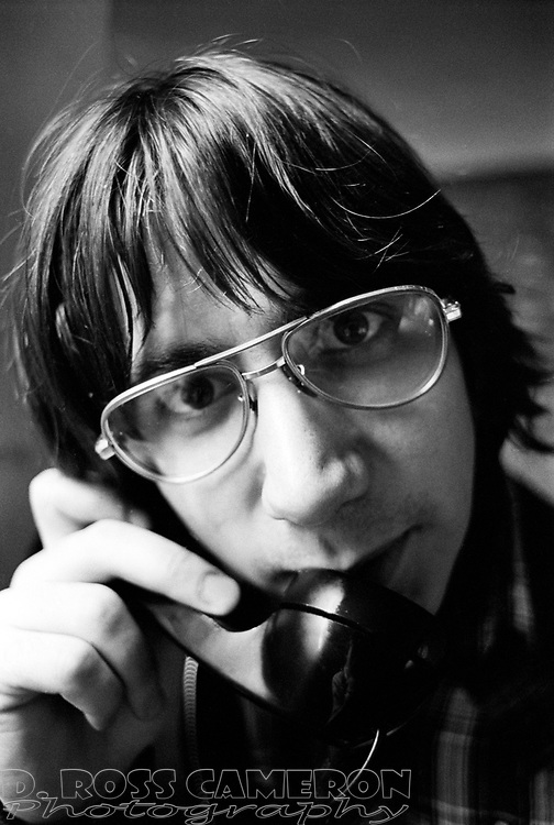 Ithaca College communications management senior Dean P. Morgans is not intimidated by a lens in his face while talking on the phone at the studios of WICB-FM campus radio in Ithaca, N.Y., March 1980. (D. Ross Cameron/The Cayugan)