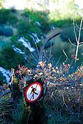 """No Hiking"" sign on edge of steep cliff, Plitvice National Park, Croatia"