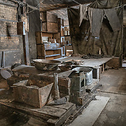 Interior of the Discovery Hut showing a sleeping platform and a blubber stove which they used for cooking and heating. Shackleton used the hut during his 1907-1908 Nimrod expedition, Scott used it during his 2nd expedition, the 1911 Terra Nova expedition, and the Ross Sea Party used it during Shackleton's failed attempt to cross the continent during the Endurance Expedition.