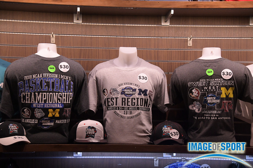 Merchandise on display during a West Regional semifinal of the NCAA men's college basketball tournament, Thursday, March 22, 2018, in Los Angeles. Michigan defeated Texas A&M 99-72.