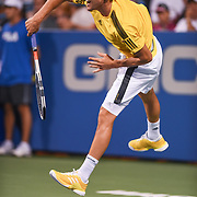 DOMINIC THIEM hits a serve during his second round match at the Citi Open at the Rock Creek Park Tennis Center in Washington, D.C.