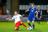Noelle Maritz (#5) of Switzerland slides in on Jane Ross (#13) of Scotland during the 2019 FIFA Women's World Cup UEFA Qualifier match between Scotland Women and Switzerland at the Simple Digital Arena, St Mirren, Scotland on 30 August 2018.
