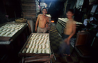 Very early morning in Ho Chi Minh City Vietnam, bakers make loaves for the coming day. 2007.