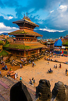 Looking from the Nyatapola Pagoda across Taumadhi Square to the Bhairav Temple (on left), Bhaktapur, Kathmandu Valley, Nepal.