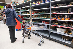© Licensed to London News Pictures. 03/03/2020. London, UK. A shopper looks for pasta in almost empty shelves in a Asda supermarket in Wembley as more Coronavirus disease cases are reported in the the UK. Photo credit: London News Pictures