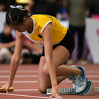 Tiffany Yau (#448) of Nanyang Girls' High starts the first leg in the B Division girls' 4x100m relay final. (Photo © Eileen Chew/Red Sports)