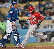 The Angels' Rey Navarro scores past Dodgers' catcher A.J. Ellis during the Angels' Freeway Series game against the Dodgers Thursday night at Dodger Stadium.<br /> <br /> ///ADDITIONAL INFO:   <br /> <br /> freeway.0401.kjs  ---  Photo by KEVIN SULLIVAN / Orange County Register  --  3/31/16<br /> <br /> The Los Angeles Angels take on the Los Angeles Dodgers at Dodger Stadium during the Freeway Series Thursday.<br /> <br /> <br />  3/31/16