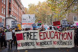 Thousands of students assemble behind a banner for a National Demonstration for a Free Education on 4th November 2015 in London, United Kingdom. The demonstration was organised by the National Campaign Against Fees and Cuts (NCAFC) in protest against tuition fees and the Government's plans to axe maintenance grants with effect from 2016.