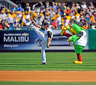 Pittsburgh Pirates' mascot Pirate Parrot mimics Xavier Nady of the Pittsburgh Pirates during pregame warmups before the Pirates' home opener against the Cubs April 7.