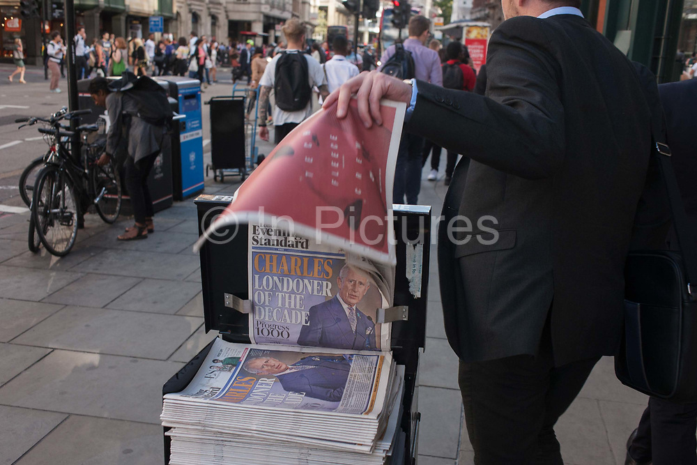 A businessman takes a free newspaper with the headline featuring a portrait of Prince Charles, the Londoner of the decade, according to the Evening Standard, on 8th September 2016, in the City of London, England UK. The Standard has listed the most influential people from all walks of life and published the list in a booklet supplement. Charles, heir to the British throne, although living in at Highgrove in Gloucestershire may not be the publics first candidate for this title.