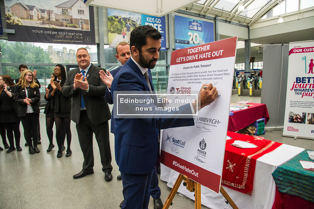 Pictured: Mr Yousaf signs the pledge<br /> Humza Yousaf, MSP, minister for Transport and the Islands joined the Edinburgh Community Safety Partnership as they officially launched Edinburgh's Transport Charter aimed at eradicating hate crime on all forms of transport in the city. Each of the organisations involved with the partnership will outline their approach to responding to incidents.  The launch will be followed by two days of action where representatives will be in transport hubs, promoting an understanding of hate crime, raising awareness of the charter and how to report unacceptable behaviours. Charter Representatives: Transport and Environment Convener, Lesley Macinnes, Alex Hynes from the Scotrail Alliance, Michael Powell from Edinburgh Trams, Jason Hackett from First Buses, Superintendent Richard Horan from Police Scotland, Chief Inspector Sue Maxwell from British Transport Police and Transport Scotland. Allister McKillop Vice Chair of Equality Transport Advisory Group (ETAG) and representatives from the Access Panel, Hollaback, SCOREScotland, NKS, Edinburgh Women's Interfaith Group and SESTran along with students from Currie High School<br /> <br /> Ger Harley   EEm 27 June  2017