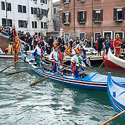 VENICE, ITALY - FEBRUARY 16:  Rowers dressed with costumes take part in the traditional regatta on the Grand Canal which officially opens the Carnival  on February 16, 2014 in Venice, Italy. The 2014 Carnival of Venice will run from February 15 to March 4 and includes a program of gala dinners, parades, dances, masked balls and music events.  (Photo by Marco Secchi/Getty Images)