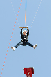 "© Licensed to London News Pictures. 10/06/2015. London, UK. Emma Willis takes part in a ""leap of faith"" stunt at the new BBC Broadcasting House. Photo credit : Vickie Flores/LNP"