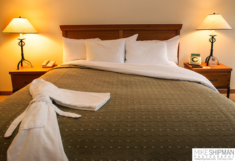 5-star hotel room detail with plush robe on bed, Vancouver Island, British Columbia