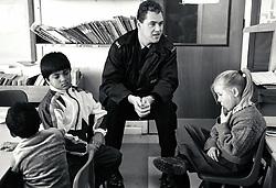Policeman visiting Arkwright primary school, Derbyshire UK 1992