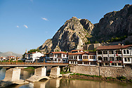 Ottoman villas of Amasya along the banks of the river Yesilırmak , below the Pontic Royal rock tombs and mountain top ancient citadel, Turkey .<br /> <br /> If you prefer to buy from our ALAMY PHOTO LIBRARY  Collection visit : https://www.alamy.com/portfolio/paul-williams-funkystock/amasya-turkey.html<br /> <br /> Visit our TURKEY PHOTO COLLECTIONS for more photos to download or buy as wall art prints https://funkystock.photoshelter.com/gallery-collection/3f-Pictures-of-Turkey-Turkey-Photos-Images-Fotos/C0000U.hJWkZxAbg