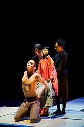 "© Copyright licensed to London News Pictures. 05/11/2010. Young Sasuke (Songha Cho) is in the mood for love as Shun-Kin (Puppeteers Eri Fukatsu, Junko Uchida, Yasuyo Mochizuki) approaches. Complicite present ""Shun-Kin"" at the Barbican, London. Directed by Simon McBurney, based on the writings of Jun'ichiro Tanizaki."