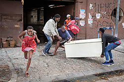 JOHANNESBURG, April 17, 2020  People run out of a building due to a fire accident in Johannesburg, South Africa, April 16, 2020..  South Africa's COVID-19 deaths jumped by 14 in 24 hours as the novel coronavirus sickened 99 more people, Health Minister Zweli Mkhize said on Thursday. .  The total number of COVID-19 cases in the country has reached 2,605, the minister said. (Photo by YeshielXinhua) (Credit Image: © Xinhua via ZUMA Wire)