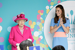 © Licensed to London News Pictures. 12/06/2016. Britain's Queen Elizabeth II is applauded by Kate, Duchess of Cambridge after she made a speech during the Patron's Lunch. As part of the celebrations for Queen Elizabeth II's 90th birthday it is a street party celebrating The Queen's patronage of charities and organisations. Photo credit: Tim Ireland/LNP