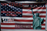 Banner advertising the popular American Visa Lottery that grants lucky winners visas into the United States. October 25, 2017. Kaneshie Market, Ghana. Reuters/Francis Kokoroko