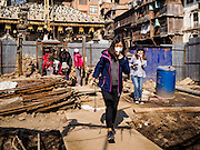 05 MARCH 2017 - KATHMANDU, NEPAL: Tourists walk through an empty lot being rebuilt after the 2015 earthquake. Much of Kathmandu is now a construction site because of rebuilding  two years after the earthquake of 25 April 2015 that devastated Nepal. In some villages in the Kathmandu valley workers are working by hand to remove ruble and dig out destroyed buildings. About 9,000 people were killed and another 22,000 injured by the earthquake. The epicenter of the earthquake was east of the Gorka district.      PHOTO BY JACK KURTZ