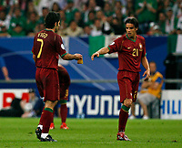 Photo: Glyn Thomas.<br />Portugal v Mexico. FIFA World Cup 2006. 21/06/2006.<br /> Portugal's captain Luis Figo (L) gives the captain's armband to Nuno Gomes as he is substituted.