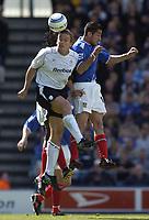 Fotball<br /> England 2004/2005<br /> Foto: SBI/Digitalsport<br /> NORWAY ONLY<br /> <br /> Portsmouth v Bolton, Barclays Premiership, 07/05/2005. <br /> <br /> Bolton's Kevin Davies outjumps the Portsmouth defence.