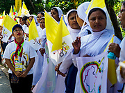 27 NOVEMBER 2017 - YANGON, MYANMAR: Catholic nuns wait for the Pope's motorcade in Yangon. Pope Francis arrived in Yangon Monday for a four day / three night visit. Tuesday he is going to the capitol, Naypyidaw (Nay Pyi Taw) to meet with Aung San Suu Kyi and other Myanmar leaders. Wednesday and Thursday he is saying mass in Yangon and on Thursday afternoon he is going to neighboring Bangladesh. There are around 450,000 Catholics in Burma, about 1% of the total population.   PHOTO BY JACK KURTZ