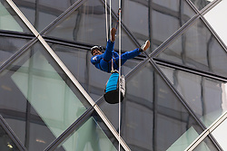 London, September 7th 2015. PICTURED: Jimmy Demetriou descends from the heights of the Gerkhin where he is the building Manager. The Outward Bound Trust City Three Peaks Challenge in conjunction with The Royal Navy and Royal Marines Charity is a breathtaking abseiling endeavour on the greatest urban mountain range: The City of London.